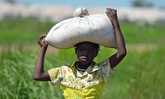 girl-carrying-enchance-worldwide
