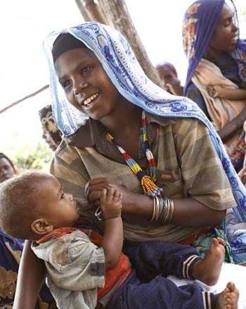 Woman with Baby   Enhance Worldwide